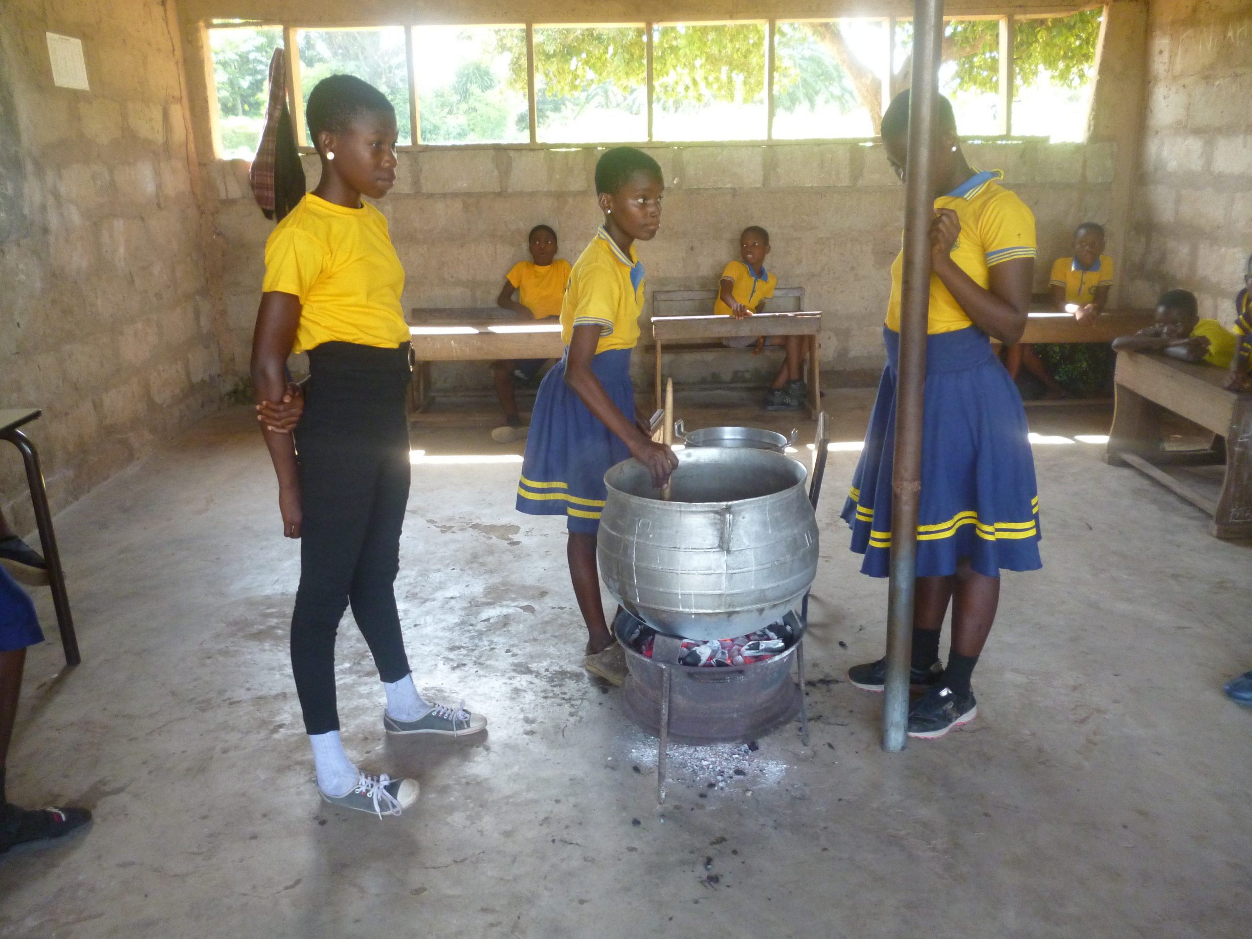 Girls making black soap